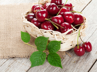 Ripe cherries on wooden table