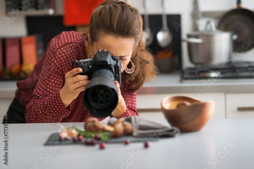 Young woman photographing food - 77387412