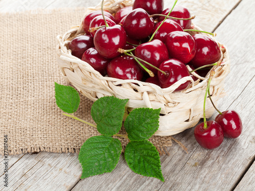Ripe cherries on wooden table © karandaev