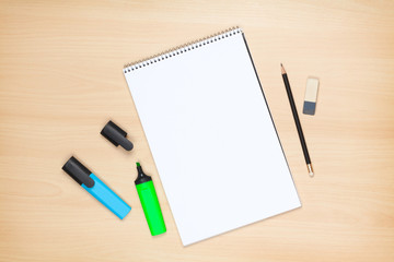 Blank notepad, highlighters, pencil and eraser