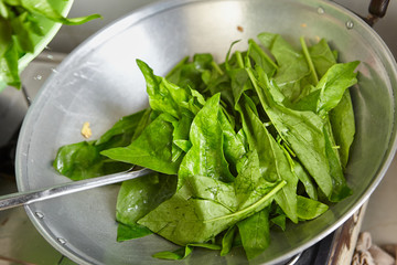 Sauteing Japanese spinach