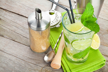 Fresh mojito cocktail and bar utensils