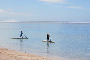 Cook Islands, Rarotonga, Two boys paddle boarding