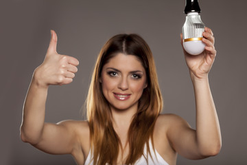Young smiling woman advertising a new LED Technology