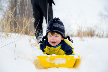 Boy on sledge (2-3 years)