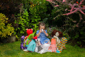 Girl having tea party with toys (2-3 years)