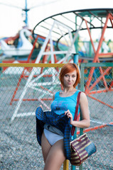 Young red-haired girl-student raised her short skirt