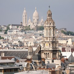 France, Paris, Montparnasse cityscape with cathedral tower in foreground
