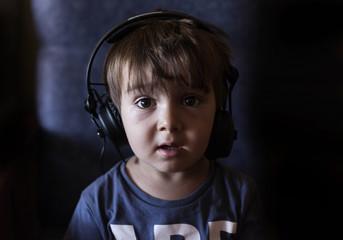 Boy (2-3) listening music