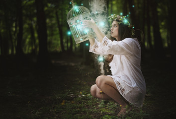 Woman with ghost lights in secret forest