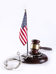 Gavel, handcuff and American flag