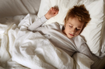 Boy (12-13) sleeping in bed