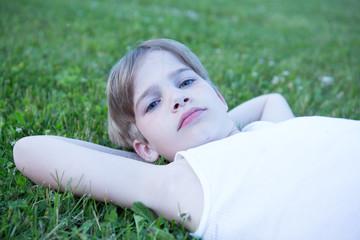 USA, Pennsylvania, Lancaster County, Lancaster, Portrait of boy laying on grass