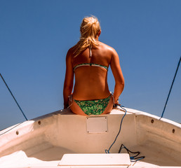 Venezuela, Woman sitting on boat
