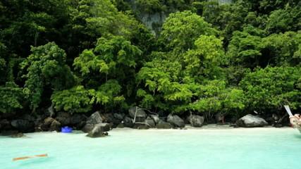 Andaman Sea tourist vessel on white sandy beaches, Thailand