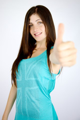 Happy beautiful girl thumb up