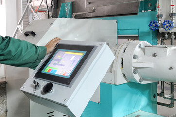 man operating factory machinery