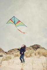 Ireland, County Wicklow, Brittas Bay, Boy ( 4-5) flying a kite on beach