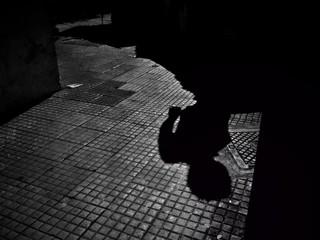 Brazil, Sao Paulo, Shadows of man on sidewalk