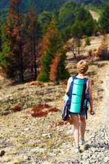 Rear view of young woman hiking