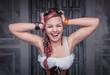 Beautiful steampunk woman in corset screaming
