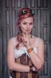 Beautiful steampunk woman in corset making silence gesture