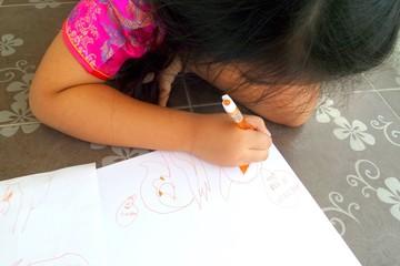 girl drawing and writing cartoon