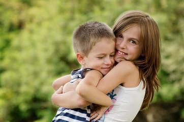 Bulgaria, Siblings (4-5, 8-9) hugging