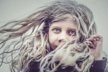 Portrait of girl (8-9) with hair blowing in wind