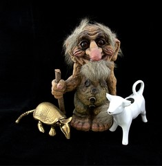 Norwegian troll figurine with walking stick and armadillo