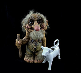 Norwegian troll figurine with walking stick and porcelain cow