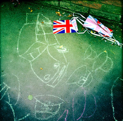 UK, England, London, Chalk drawings on sidewalk and bunting next to it