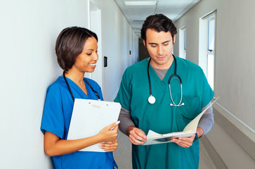 Two doctors in hospital corridor