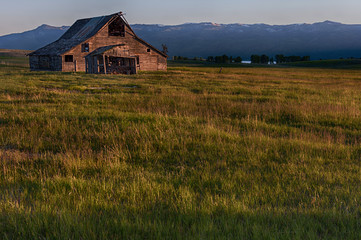 USA, Idaho, Valley County, Cascade, Old Barn at Sunset