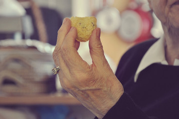 Elderly lady eating cake