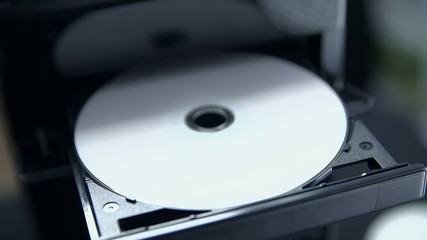 Opening CD/DVD tray writing DATA on disc