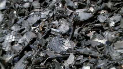 shredded car tires pile for recycling. zoom in.