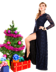 Portrait of a beautiful young woman near the Christmas tree