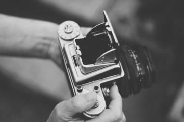 United Kingdom, England, Warwickshire, Stratford-upon-Avon, Woman holding old vintage medium format camera