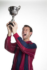 Football player lifting trophy