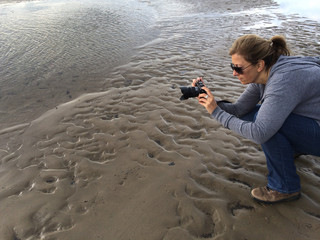 UK, Wales, Woman Photographing On Beach