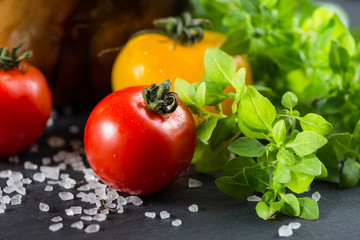 Farm fresh tomatoes with fresh basil herb and rock salt