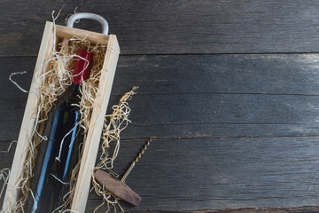 Vintage wooden wine case and corkscrew from above