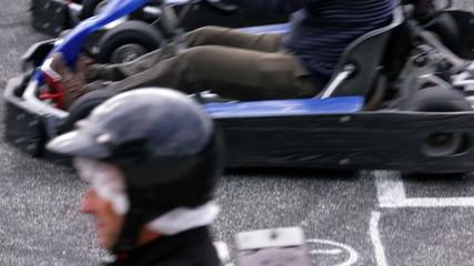 Go-kart racers start the race