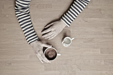 USA, Wyoming, Woman holding cup of coffee