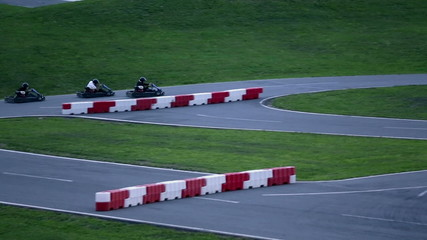 Go-cart competitors racing on the winding road