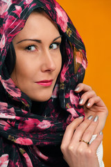 Pretty woman's look, with floral headscarf