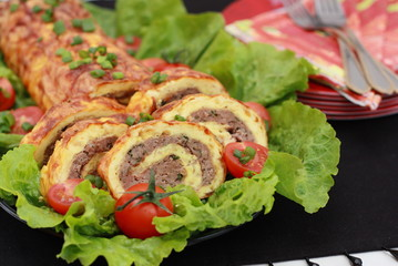 Meat roll with eggs and cheese