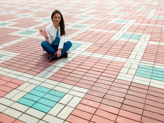 Image of woman sitting on the paving slab