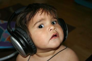 United Kingdom, England, London, Portrait of little boy using headphones